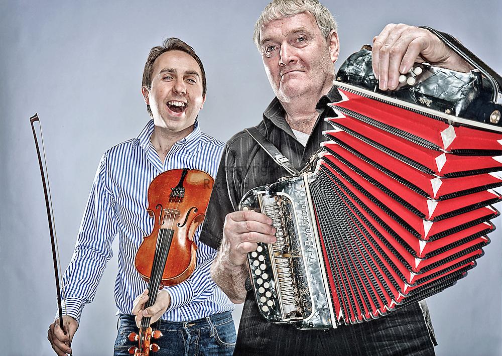 2011 MARCH 24 SEATTLE WASHINGTON - Irish musicians Oisin Mac Diarmada, left, and Seamus Begley in Georgetown, Seattle, WA. CREDIT: Richard Walker