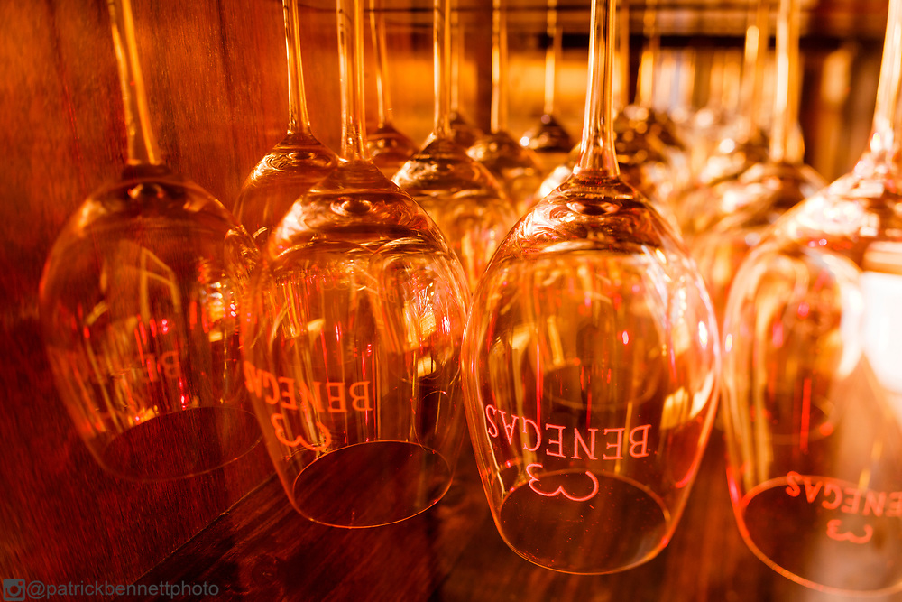 Wine glasses hanging in the guest dining room at Bodega Benegas in Cruz de Piedra, Mendoza, Argentina.