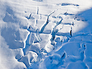 Glacier crevasses form a pattern in the Alaska Range, Denali National Park and Preserve, USA.