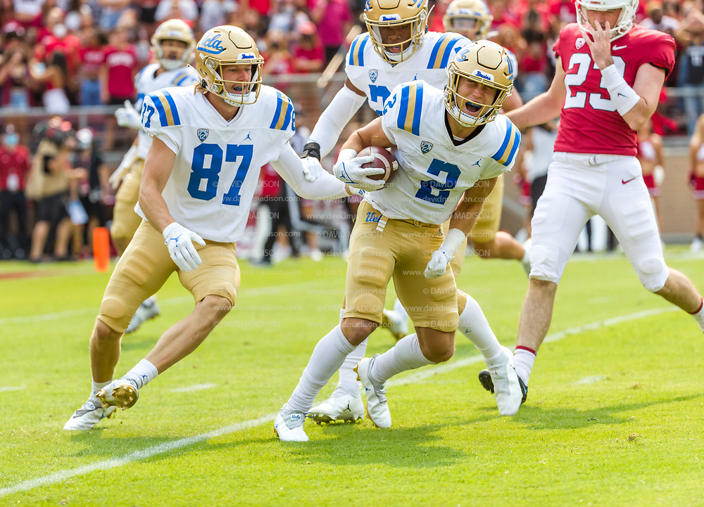 PALO ALTO, CA - SEPTEMBER 26:  Kyle Phillips #2 of the UCLA Bruins celebrates a kick return during an NCAA Pac-12 college football game against the Stanford Cardinal on September 26, 2021 at Stanford Stadium in Palo Alto, California; also visible is Grant Norberg #87.  (Photo by David Madison/Getty Images)