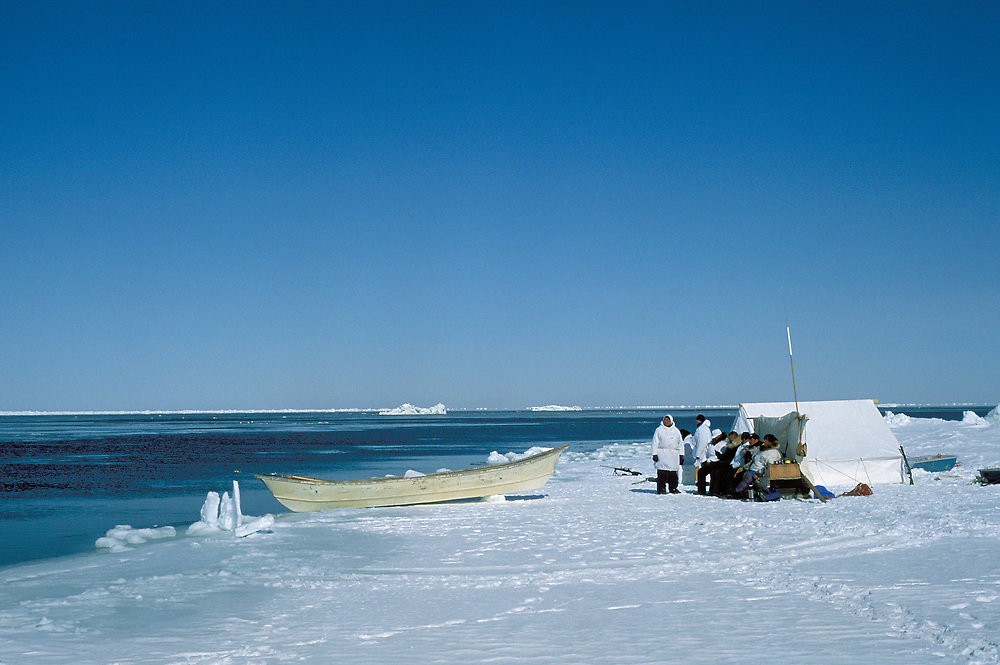 Barrow, Alaska, Whaling crew waiting by the edge of the sea ice for a sighting of a bowhead whale