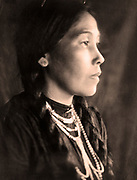 Head-and-shoulders portrait, facing right, of Native American woman by, 1907. Photograph by J.A. Haran.