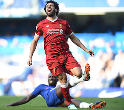 Liverpool's Mohamed Salah is tackled by Chelsea's Antonio Rudiger