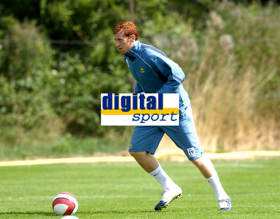 Photo: Daniel Hambury.<br />West Ham United Media Day. 10/08/2006.<br />James Collins runs with the ball during traininng.