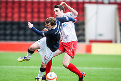 Falkirk's David Weatherston and Airdrie United's Grant Evans..Airdrie United 0 v 1 Falkirk, 30/3/2013..©Michael Schofield..