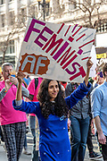 """San Francisco, USA. 19th January, 2019. At the Women's March San Franciscoa woman of color proudly holds a sign reading: """"Feminist AF."""" Credit: Shelly Rivoli/Alamy Live News"""