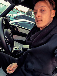 """Mesut Oezil releases a photo on Twitter with the following caption: """"""""On my way home from the last training session before the Newcastle game. Tomorrow, we will work as hard as we can in order to start a new unbeaten run at the Emirates! Let's do this together, Gooners!👊🏼💥 #AFCvNUFC #Arsenal 🔴⚪"""""""". Photo Credit: Twitter *** No USA Distribution *** For Editorial Use Only *** Not to be Published in Books or Photo Books ***  Please note: Fees charged by the agency are for the agency's services only, and do not, nor are they intended to, convey to the user any ownership of Copyright or License in the material. The agency does not claim any ownership including but not limited to Copyright or License in the attached material. By publishing this material you expressly agree to indemnify and to hold the agency and its directors, shareholders and employees harmless from any loss, claims, damages, demands, expenses (including legal fees), or any causes of action or allegation against the agency arising out of or connected in any way with publication of the material."""