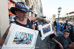 Selling framed prints on the Strand during the Lone Star Rally. Galveston, TX. USA. Saturday November 4, 2017. Photography ©2017 Michael Lichter.
