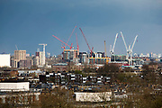 Construction cranes over the London skyline from Primrose Hill, London, England, United Kingdom.