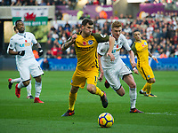 Football - 2017 / 2018 Premier League - Swansea City vs. Brighton & Hove Albion<br /> <br /> Pascal Gross of Brighton and Hove Albion & Sam Clucas of Swansea City , at The Liberty Stadium.<br /> <br /> COLORSPORT/WINSTON BYNORTH