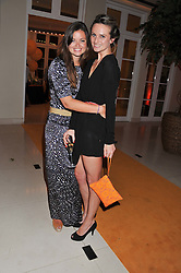 Left to right, LADY NATASHA RUFUS-ISAACS and BRYONY DANIELS at the Veuve Clicquot Experience at The Hurlingham Party following the Polo in The Park held at the Hurlingham Club, London SW6 on 8th June 2012.