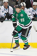 DALLAS, TX - OCTOBER 17:  Sergei Gonchar #55 of the Dallas Stars controls the puck against the San Jose Sharks on October 17, 2013 at the American Airlines Center in Dallas, Texas.  (Photo by Cooper Neill/Getty Images) *** Local Caption *** Sergei Gonchar