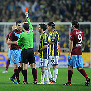 Referee's Cuneyt Cakir show the red card to Trabzonspor's Aykut Akgun (L) during their Turkish superleague soccer derby match Fenerbahce between Trabzonspor at the Sukru Saracaoglu stadium in Istanbul Turkey on Sunday 18 December 2011. Photo by TURKPIX