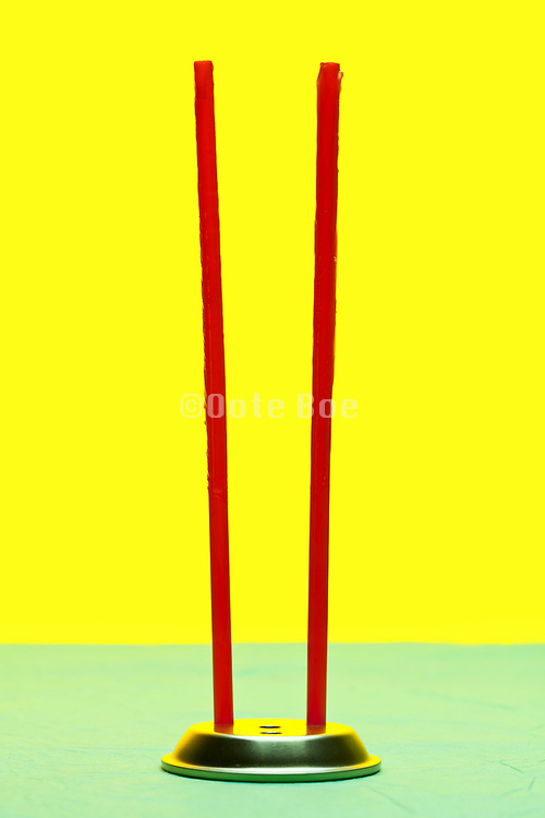 standing red straws that are covered with a sticky glue substance to catch flies