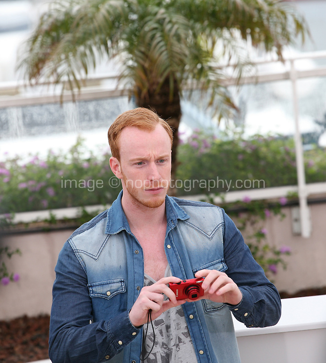 William Ruane takes a photo of the press photographers at The Angel?s Share photocall at the 65th Cannes Film Festival France. The Angel's Share is directed by Ken Loach. Tuesday 22nd May 2012 in Cannes Film Festival, France.