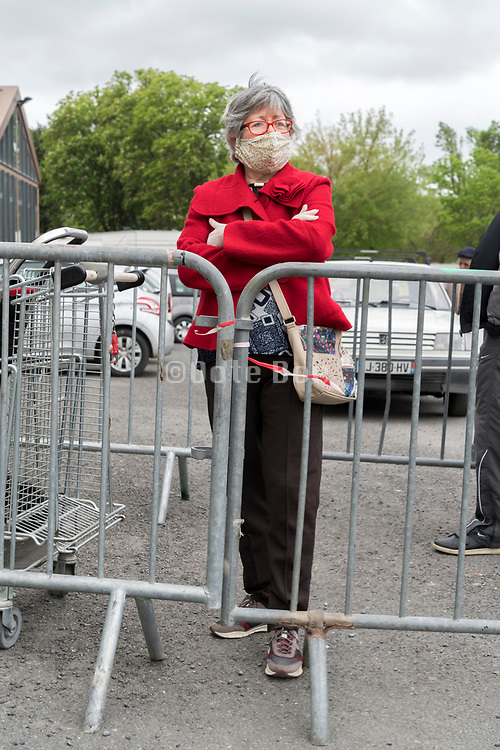 shopper waiting in line for shopping during Covid 19 crisis France Limoux April 2020