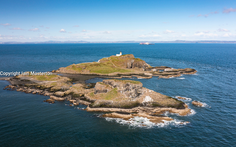Aerial view from drone of Fidra Island and lighthouse in Firth of Forth, East Lothian, Scotland, UK