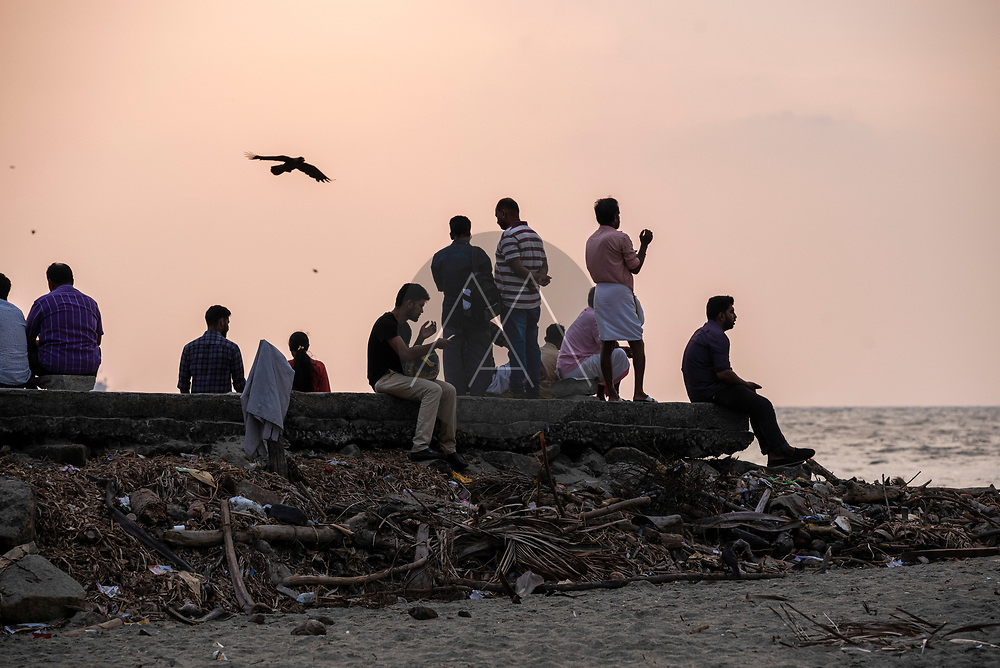 Kochi, India - 05 April 2019: view of people on the beach at sunset in Kochi, Kerala, India.