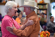 Master flatterer Arnold greets Opal Phillips, a volunteer at the Anderson County Senior Center.