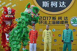 October 28, 2017 - Shanghai, China - (Left-Righ) Warren Barguil, Christopher FROOME and Marcel KITTEL during Lion Dance performance, at the 1st TDF Shanghai Criterium 2017 - Media Day..On Saturday, 28 October 2017, in Shanghai, China. (Credit Image: © Artur Widak/NurPhoto via ZUMA Press)