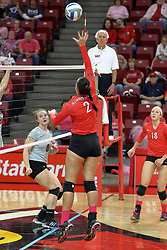 12 October 2013:  Leighann Hranka tips towards Olivia Brand during an NCAA womens volleyball match between the Missouri State Bears and the Illinois State Redbirds at Redbird Arena in Normal IL