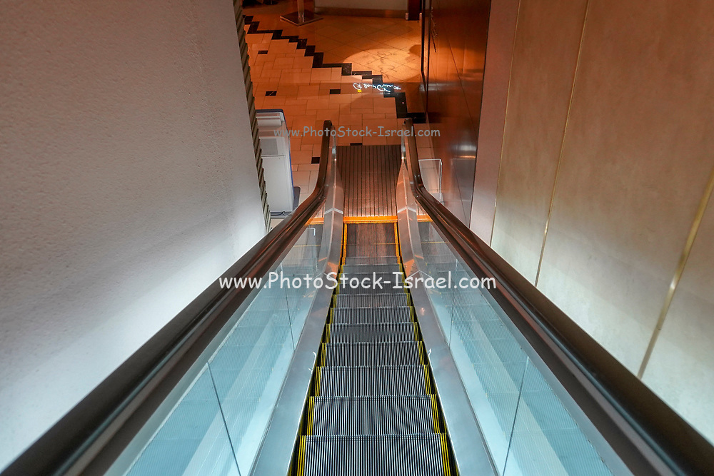 looking down an Escalator. Photographed in Tokyo, Japan