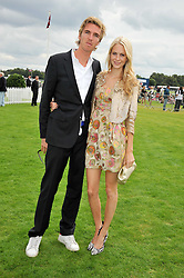 JAMES COOKE and POPPY DELEVINGNE at the 25th annual Cartier International Polo held at Guards Polo Club, Great Windsor Park, Berkshire on 26th July 2009.