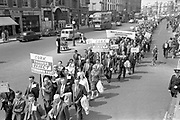 03/07/1963<br /> 07/03/1963<br /> 03 July 1963<br /> RGDATA Turnover Tax Protest March in Dublin. Picture shows RGDATA delegates who marched through Dublin to Government Buildings to present their protest to against the proposed Turnover Tax to the Minister for Finance marching down Westmoreland Street. Note traffic Garda with white sleeves.