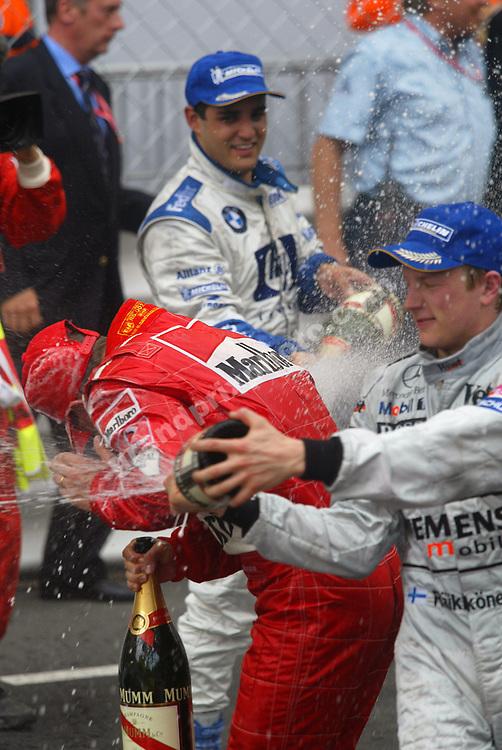 Winner Juan-Pablo Montoya (Williams - behind), second-placed Kimi Raikkonen (McLaren-Mercedes - right) and third-placed Michael Schumacher celebrate after the 2003 Monaco Grand Prix.  Photo: Grand Prix Photo