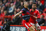Doncaster Rovers defender Niall Mason (2) and Charlton Athletic forward Nicky Ajose (25) during the The FA Cup 2nd round match between Charlton Athletic and Doncaster Rovers at The Valley, London, England on 1 December 2018. Photo by Toyin Oshodi