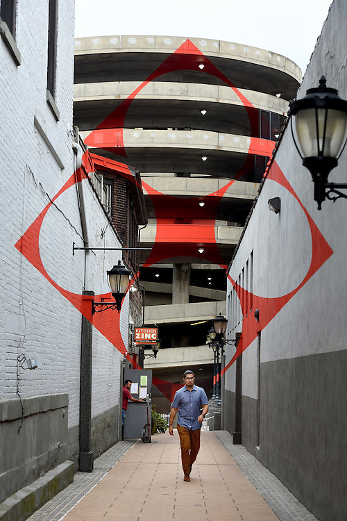 """Photo by Mara Lavitt -- Special to the Hartford Courant<br /> August 25, 2015 <br /> A new app is available to find public art in New Haven including """"Square with four circles"""" by Felice Varini in a passageway off Chapel St."""