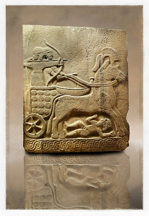 Picture & image of a Neo-Hittite orthostat with a chariot Releif sculpture from Karkamis,, Turkey. Museum of Anatolian Civilisations, Ankara. The Chariot is pulled by horses with plumed headresses. One man os about to shoot an arrow from his bow, the other man is driving the cahriot. Below the horse is a man dying. 5