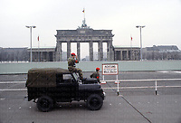 Members of the Royal Military Police (RMP) stand on sentry by the West/East Berlin border, with the infamous Brandenburg Gate in the background. They are leaning on a military modified Land Rover, which model is still in service to this day in the British Army. Photograph by Terry Fincher