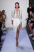 A model walks the runway wearing Altuzarra Spring 2014 during Mercedes-Benz Fashion Week in New York on September 5, 2013