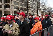 Crowds wait in line to pass a security check to enter the inaugural parade route.<br />
