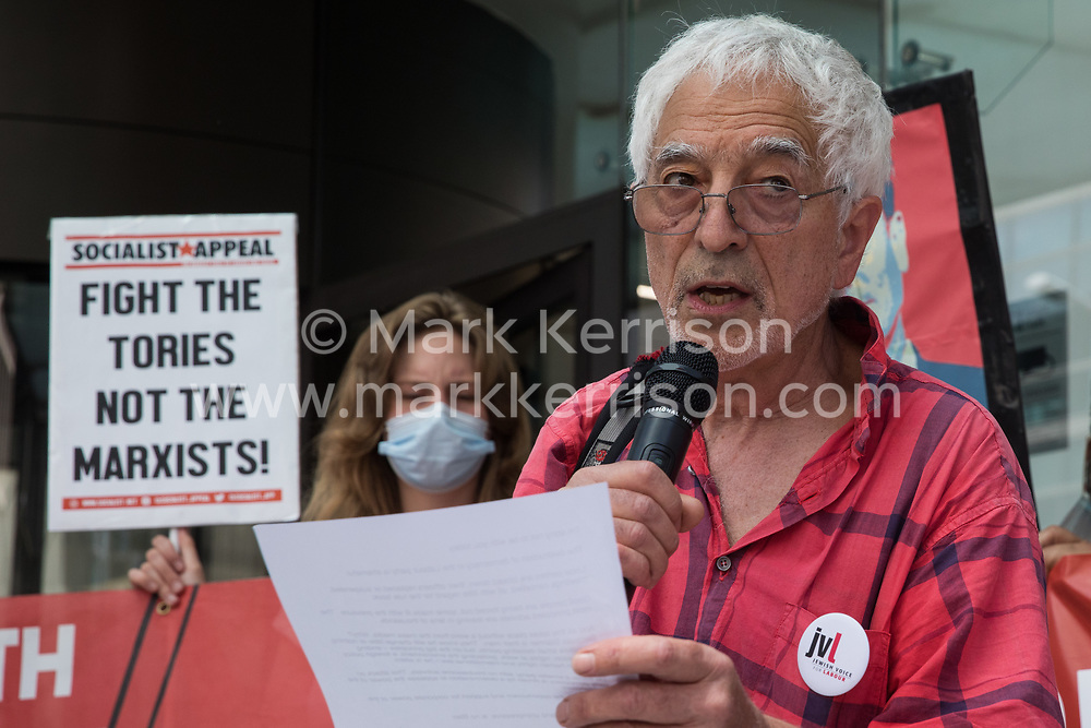 London, UK. 20th July, 2021. Glyn Secker of Jewish Voice for Labour reads a message of solidarity from film director Ken Loach at a protest lobby outside the Labour Party's headquarters by supporters of left-wing groups, including some suspended members. The lobby was organised to coincide with a Labour Party National Executive Committee meeting during which it was asked to proscribe four organisations, Resist, Labour Against the Witchhunt, Labour In Exile and Socialist Appeal, members of which could then be automatically expelled from the Labour Party.