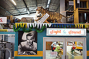Shopping at Cappele's - the most famous supermarket. Spam, Corned Beef and Chicken are the best selling items, but you can also find a stuffed Tiger and an Errol Flynn poster...Nauru, officially the Republic of Nauru is an island nation in Micronesia in the South Pacific.  Nauru was declared independent in 1968 and it is the world's smallest independent republic, covering just 21 square kilometers..Nauru is a phosphate rock island and its economy depends almost entirely on the phosphate deposits that originate from the droppings of sea birds. Following its exploitation it briefly boasted the highest per-capita income enjoyed by any sovereign state in the world during the late 1960s and early 1970s..In the 1990s, when the phosphate reserves were partly exhausted the government resorted to unusual measures. Nauru briefly became a tax haven and illegal money laundering centre. From 2001 to 2008, it accepted aid from the Australian government in exchange for housing a Nauru detention centre, with refugees from various countries including Afghanistan and Iraq..Most necessities are imported on the island..Nauru has parliamentary system of government. It had 17 changes of administration between 1989 and 2003. In December 2007, former weight lifting medallist Marcus Stephen became the President.
