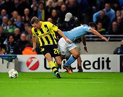 Manchester City's Sergio Aguero is fouled by Borussia Dortmund's Lukasz Piszczek - Photo mandatory by-line: Joe Meredith/JMP  - Tel: Mobile:07966 386802 03/10/2012 - Manchester City v Borussia Dortmund - SPORT - FOOTBALL - Champions League -  Manchester   - Etihad Stadium -
