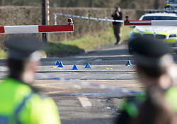 © Licensed to London News Pictures. 17/02/2018. Horsham, UK. Blue evidence markers are seen on a railway level crossing  where two people have been killed near the village of Barns Green after a train hit a car. Photo credit: Peter Macdiarmid/LNP