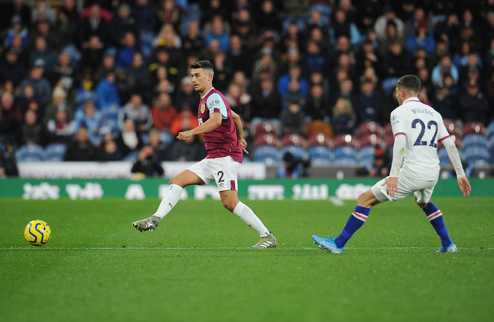 Burnley's Matthew Lowton under pressure from Chelsea's Christian Pulisic<br /> <br /> Photographer Kevin Barnes/CameraSport<br /> <br /> The Premier League - Burnley v Chelsea - Saturday 26th October 2019 - Turf Moor - Burnley<br /> <br /> World Copyright © 2019 CameraSport. All rights reserved. 43 Linden Ave. Countesthorpe. Leicester. England. LE8 5PG - Tel: +44 (0) 116 277 4147 - admin@camerasport.com - www.camerasport.com