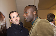 Johnny Vaughn and Ozwald Boateng. Rachel Whiteread, Haunch of Venison opening party. 28 October 2002. © Copyright Photograph by Dafydd Jones 66 Stockwell Park Rd. London SW9 0DA Tel 020 7733 0108 www.dafjones.com