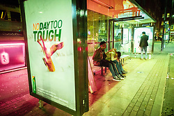 © Licensed to London News Pictures . 28/10/2018. Manchester, UK. A man sits forward , slouched over his knees , in a bus shelter in Stevenson Square in the Northern Quarter of Manchester City Centre . Revellers on a night out , many in fancy dress , on the weekend before Halloween . Photo credit: Joel Goodman/LNP