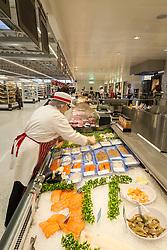 Fishmonger, new Sainsbury's superstore, Thanet, Kent UK