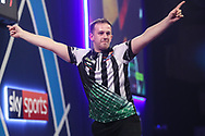 Callan Rydz hits a double and wins his first round match against Steve Lennon during the PDC William Hill World Darts Championship at Alexandra Palace, London, United Kingdom on 16 December 2019.