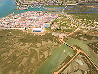 Aerial view of a city surrounded by wetland in Andalusia, Spain.