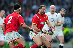 Jamie Roberts of Wales passes the ball - Mandatory byline: Patrick Khachfe/JMP - 07966 386802 - 12/03/2016 - RUGBY UNION - Twickenham Stadium - London, England - England v Wales - RBS Six Nations.