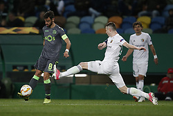 December 13, 2018 - Lisbon, Portugal - Bruno Fernandes of Sporting (L) vies for the ball with Volodymry Chesnakov of Vorskla  (R)  during UEFA Europa League football match between Sporting CP vs Vorskla, in Lisbon, on December 13, 2018. (Credit Image: © Carlos Palma/NurPhoto via ZUMA Press)