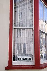 No vacancies sign in guesthouse window, Tenby, Pembrokeshire South Wales, July 2021. With foreign holidays logistically difficult due to Covid, staycations are in high demand