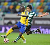 20091105: LISBON, PORTUGAL - Sporting Lisbon vs Ventspils: Europa League 2009/2010 - Group Stage. In picture: Joao Martins (VENT) and Matias Fernandez (SPO). PHOTO: Alexandre Pona/CITYFILES