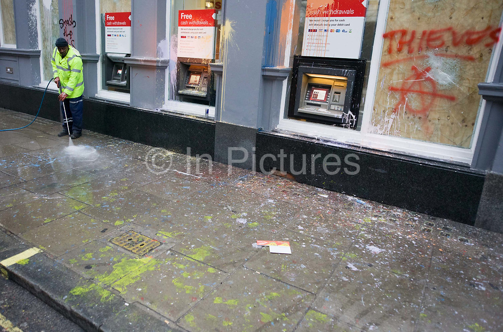 Cleaning up street the morning after the TUC-organised anti-government cuts to Britain's economy.<br /> The word Thieves has been sprayed with aerosol on a boarded-up window relating to the belief by protesters that HSBC is a tax-evader. The riot by anarchists who broke away from a largely peaceful protest agasinst government economic cuts. Organisers estimated between 250,000 and 500,000 people took part but police said a total of 201 arrests had been made during the day largely for a variety of public order offences, they said. In addition, 66 people were reported to have been injured, including at least 31 police officers, 11 of whom required hospital treatment.